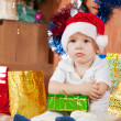 Boy sitting with Christmas gift — Stock Photo #9006993