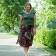 Mature woman walking in park — Stock Photo #9007017