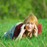 Senior woman against spring landscape — Stock Photo #9007022