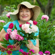 Happy mature woman in garden — Stock Photo