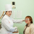 Stock Photo: Patient and doctor during physiotherapy