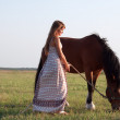 Royalty-Free Stock Photo: Young  woman with her horse