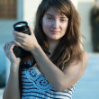 Female photographer with photocamera — Stock Photo