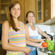 Stock Photo: Mother and daughter with vegetables