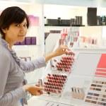 Girl is buying lipstick — Stock Photo #9007350