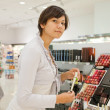 Woman in cosmetics shop — Stock Photo #9007352