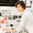 Stock Photo: Young womat cosmetics shop