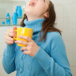 Girl gargling throat — Stock Photo #9007373