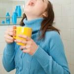 Girl gargling throat — Stock Photo #9007373