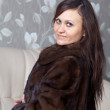 Portrait of woman in fur coat — Stock Photo