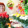 Florist in small flower shop — Stock Photo