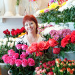 Woman in her small flower shop — Stock Photo #9007405