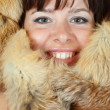 Happy girl in fox fur — Stock Photo