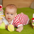 Baby girl with   baby's things — Stockfoto