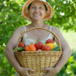 Woman with harvest — Stock Photo