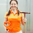 Happy woman with garden tools in greenhouse — Stock Photo