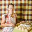 Woman cooking meat pasty — Stock Photo