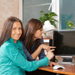 Two women using computer — Stock Photo #9007839