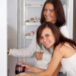 Women looking for something in the refrigerator — Stock Photo