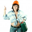 Girl in hardhat  pointing away - Foto Stock