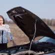 Woman calling by mobile to auto support — Stok fotoğraf #9007999
