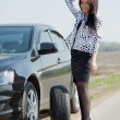 Woman during wheel changing — Stock Photo #9008004