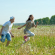 Royalty-Free Stock Photo: Boy and girl running at meadow