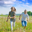 Friends running at meadow — Stock Photo