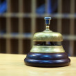 Bell on reception desk — Stock Photo