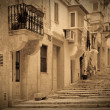 Retro photo of old picturesque street — Stock Photo