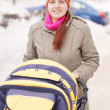 Woman with pram in winter — Stock Photo #9009172