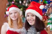 Girls in Christmas hats — Stock Photo