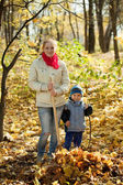 Woman with son gardening in autumn — Foto de Stock