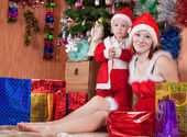Mother and little son with Christmas gifts — Stock Photo