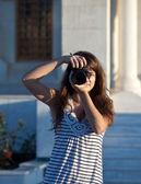 Photographer tourist takes pictures — Stock Photo