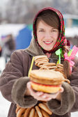 Girl with pancake during Shrovetide — Stock Photo