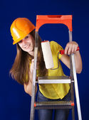 Painter girl with paint rollers — Stock Photo