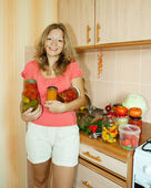 Woman with pickled vegetables — Stock Photo