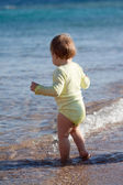 Rear view toddler in sea — Stock Photo