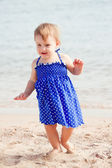 Baby girl on sand beach — Stock Photo