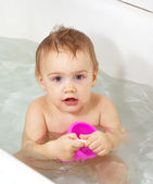 Toddler bathing in bathtub — Stock Photo