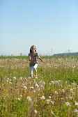 Teenager girl running at meadow — Stock Photo