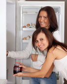 Women looking for something in the refrigerator — Stok fotoğraf