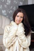 Portrait of woman in fur coat — Stock Photo