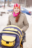 Woman with pram in winter — Stock Photo