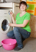 Women loading the washing machine — Stock Photo