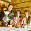 Women near  russian samovar — Stockfoto