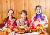 Women eats pancake during Shrovetide — Stock Photo