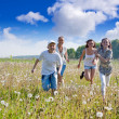 Friends running in meadow — Stock Photo #9890294