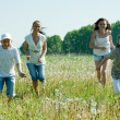 Friends running in meadow — Stock Photo #9890296